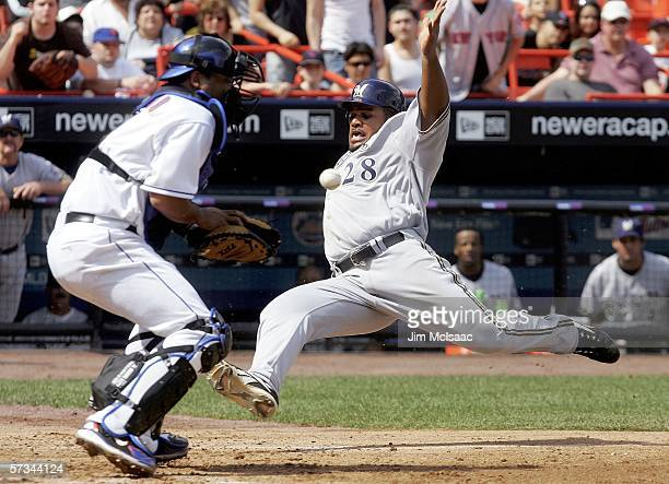 Prince Fielder of the Milwaukee Brewers beats the throw to Ramon Castro of the New York Mets to score a run in the fourth inning on April 15, 2006 at...
