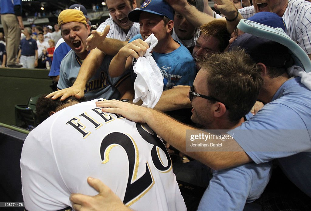 Prince Fielder #28 of the Milwaukee Brewers celebrates with the fans after the Brewers 3-2 10 inning victory against the Arizona Diamondbacks in Game Five of the National League Division Series at Miller Park on October 7, 2011 in Milwaukee, Wisconsin.
