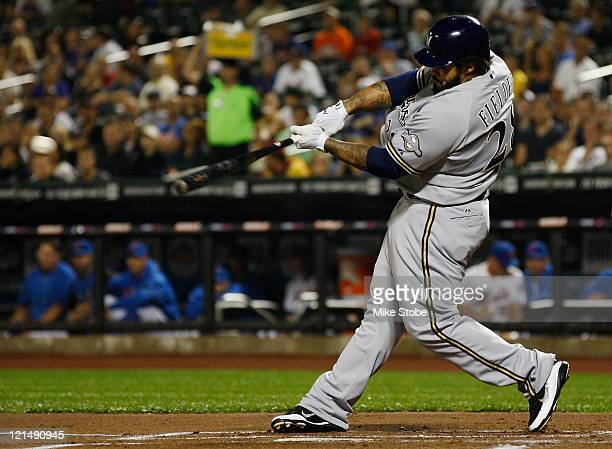 Prince Fielder of the Milwaukee Brewers hits an RBI single in the first inning against the New York Mets on August 19 2011 at Citi Field in the...