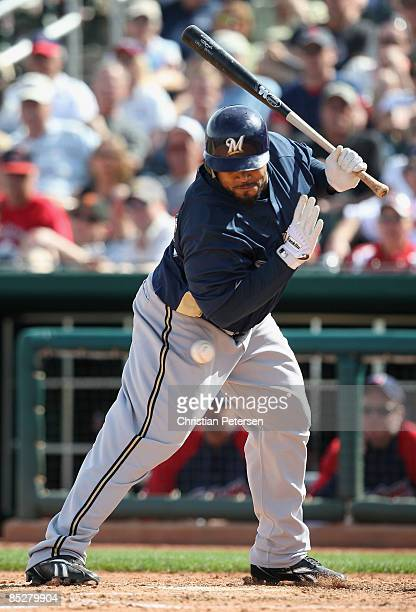 Prince Fielder of the Milwaukee Brewers is hit by a pitch during the fourth inning of the spring training game against the Cleveland Indians at...