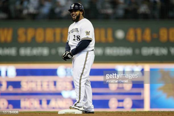 Prince Fielder of the Milwaukee Brewers reacts after hitting a double in the fourth inning against the Arizona Diamondbacks during Game One of the...