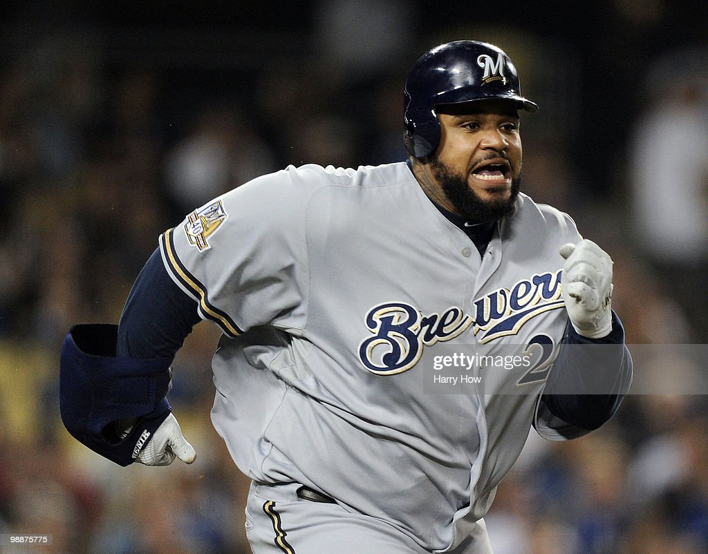 Prince Fielder #28 of the Milwaukee Brewers reacts as he beats out a throw for an infield single against the Los Angeles Dodgers during the fifth inning at Dodger Stadium on May 5, 2010 in Los Angeles, California.