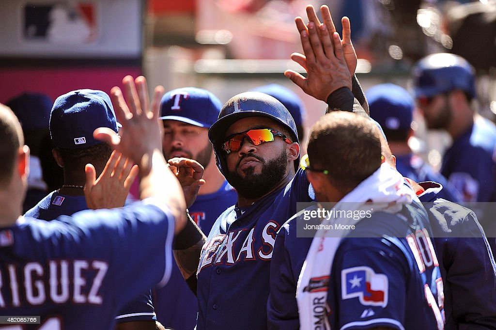 Prince Fielder #84 of the Texas Rangers celebrates after scoring on a sacrifice fly hit by Elvis Andrus #1 in the ninth inning during a game at Angel Stadium of Anaheim on July 26, 2015 in Anaheim, California.