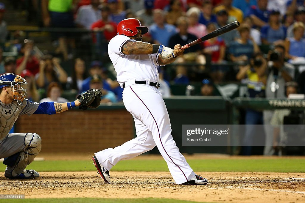 Prince Fielder #84 of the Texas Rangers hits an RBI single in the sixth inning during a game against the Los Angeles Dodgers at Globe Life Park in Arlington on June 15, 2015 in Arlington, Texas. The Texas Rangers defeated the Los Angeles Dodgers 4-1.