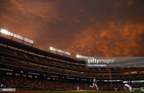 Prince Fielder of the Texas Rangers tags out Drew Stubbs of the Colorado Rockies in the top of the fourth inning at Globe Life Park in Arlington on...