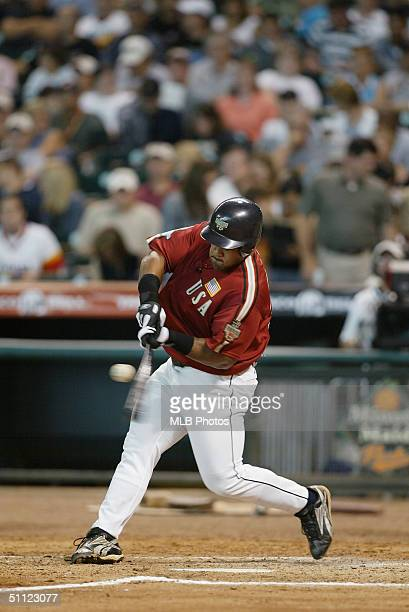 Prince Fielder of the World Team puts the bat on the ball during the New York Mercantile Exchange AllStar Futures Game against the United States Team...