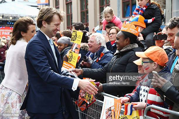Prince Floris of The Netherlands shakes hands with supporters during King's Day , the celebration of the birthday of the Dutch King, on April 27,...
