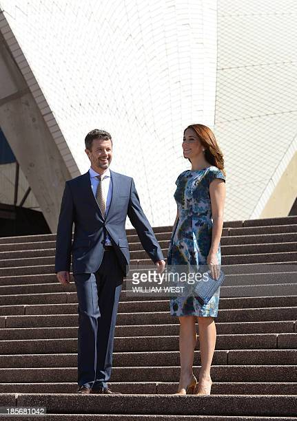 Prince Frederik and Princess Mary of Denmark pose for photographs on the steps of the Sydney Opera House on October 24 2013 The royal couple are on...
