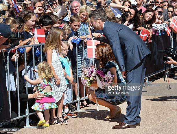 Prince Frederik and Princess Mary of Denmark receive flowers from children as they are greeted on the steps of the Sydney Opera House on October 24...