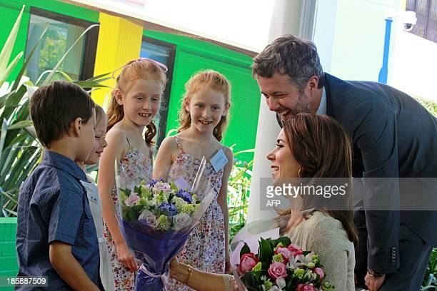 Prince Frederik and Princess Mary of Denmark speak to children on a visit to the Sydney Children's Hospital in Sydney on October 26 2013 The couple...