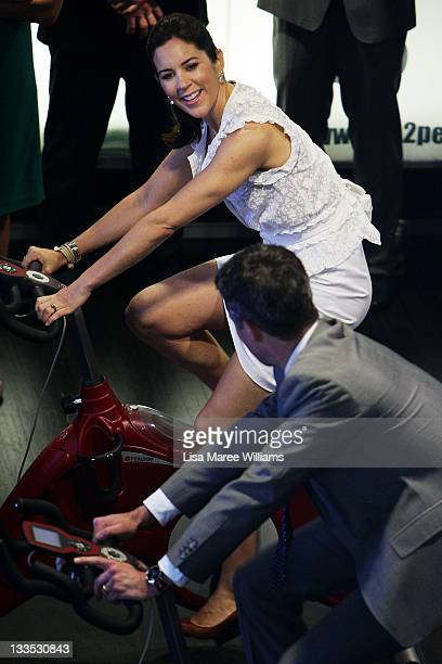 Prince Frederik and Princess Mary of Denmark test a bicycle display during the opening of 'Curating Cities SydneyCopenhagen' at Customs House on...