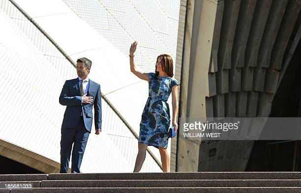 Prince Frederik and Princess Mary of Denmark wave to the locals on the steps of the Sydney Opera House on October 24 2013 The royal couple are on an...