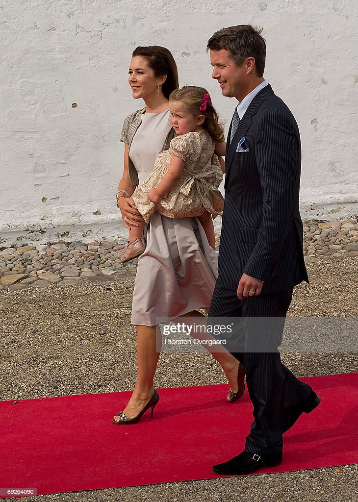 Prince Frederik and Princess Mary with Pincess Isabella arrive for the Christening of Prince Henrik Carl Joachim Alain of Denmark at Mogeltonder Church on July 26, 2009 in Mogeltonder, Denmark.