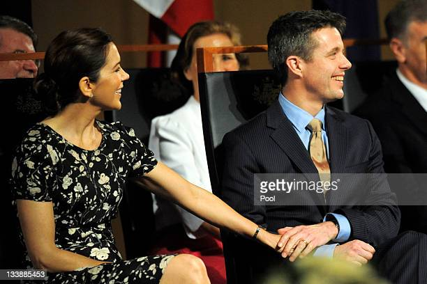 Prince Frederik of Denmark and Princess Mary of Denmark hold hands during their attendance at a luncheon given by Prime Minister Julia Gillard at...