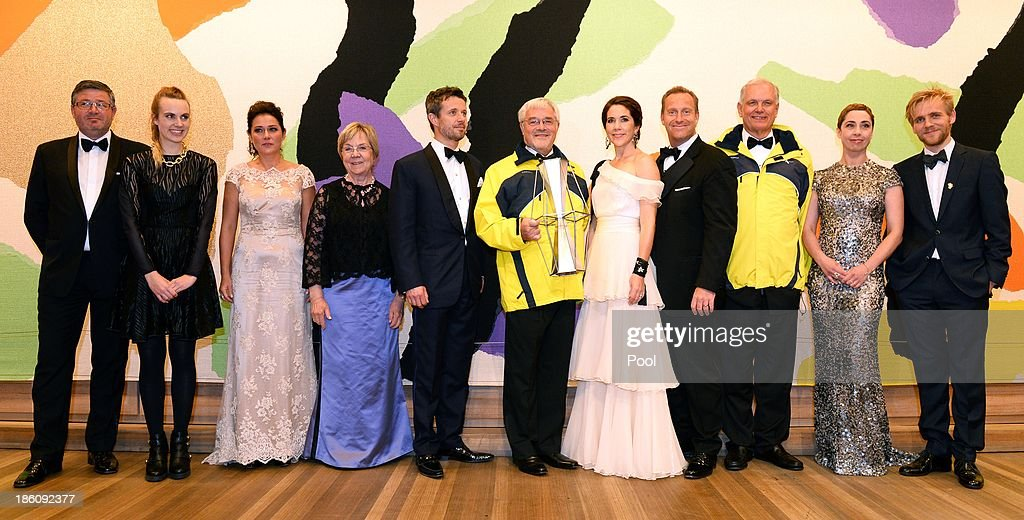 Prince Frederik of Denmark and Princess Mary of Denmark pose with winners of the Crown Prince Couple Awards 2013 held at the Sydney Opera House on October 28, 2013 in Sydney, Australia. Prince Frederik and Princess Mary are on a five day visit to Sydney and will attend events to celebrate the 40th anniversary of the Sydney Opera House and the Danish architect who designed the landmark, Jorn Utzen.