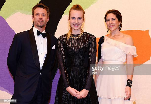 Prince Frederik of Denmark and Princess Mary of Denmark pose with singersongwriter Karen Marie Orsted joint winner of the Rising Star Award at the...