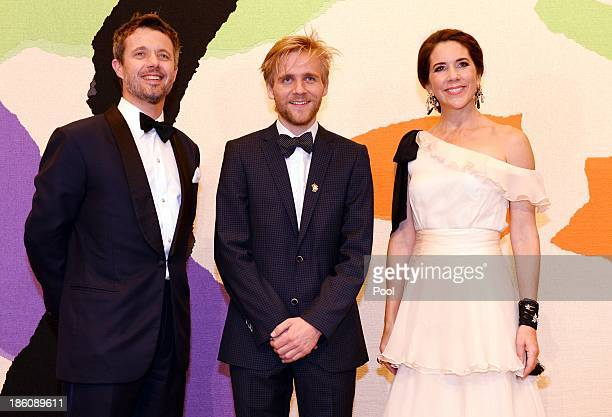 Prince Frederik of Denmark and Princess Mary of Denmark pose with violinist Rune Tonsgaard Sorensen joint winner of the Rising Star Award at the...