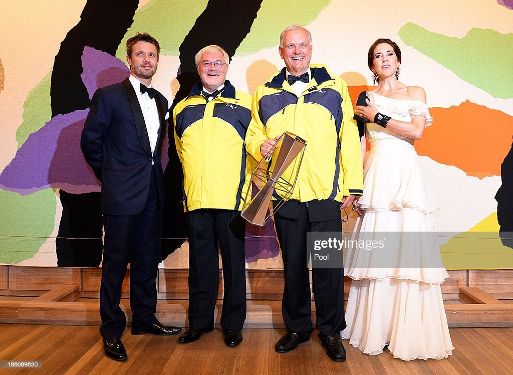 Prince Frederik of Denmark and Princess Mary of Denmark pose with Erik Thorsted (2nd L) and Stig Kjerulf (2nd R), winners of the Social Award at the Crown Prince Couple Awards 2013 held at the Sydney Opera House on October 28, 2013 in Sydney, Australia. Prince Frederik and Princess Mary are on a five day visit to Sydney and will attend events to celebrate the 40th anniversary of the Sydney Opera House and the Danish architect who designed the landmark, Jorn Utzen.