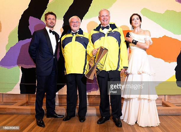 Prince Frederik of Denmark and Princess Mary of Denmark pose with Erik Thorsted and Stig Kjerulf winners of the Social Award at the Crown Prince...