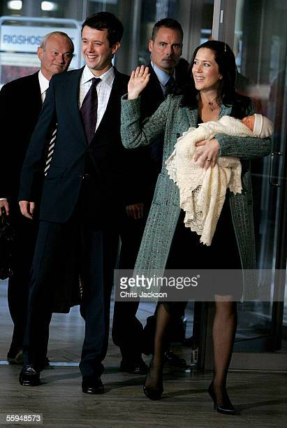 Prince Frederik of Denmark and Princess Mary of Denmark pose with their new baby son as they leave Copenhagen University Hospital on October 18, 2005...