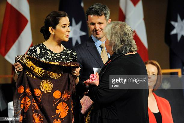 Prince Frederik of Denmark and Princess Mary of Denmark receive a present from a local aboriginal elder prior to a luncheon given by Prime Minister...