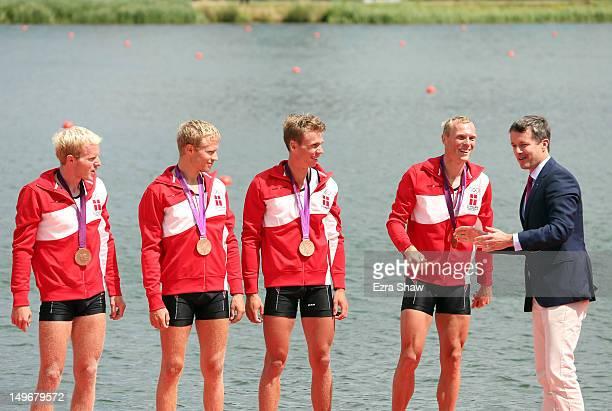 Prince Frederik of Denmark presents bronze medals to Eskild Ebbesen Jacob Barsoe Morten Jorgensen and Kasper Winther of Denmark during the medal...