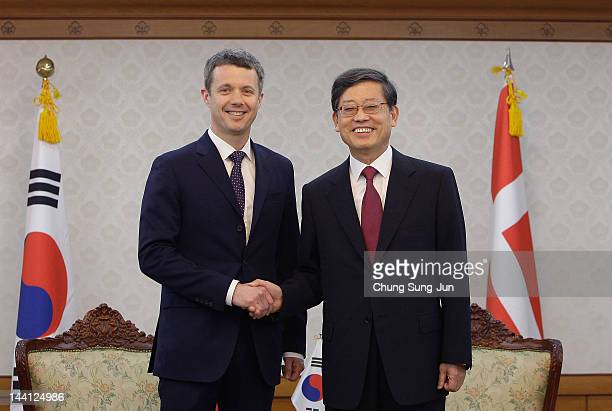 Prince Frederik of Denmark shakes hands with South Korean Prime Minister Kim Hwang-Shik at the government complex on May 10, 2012 in Seoul, South...