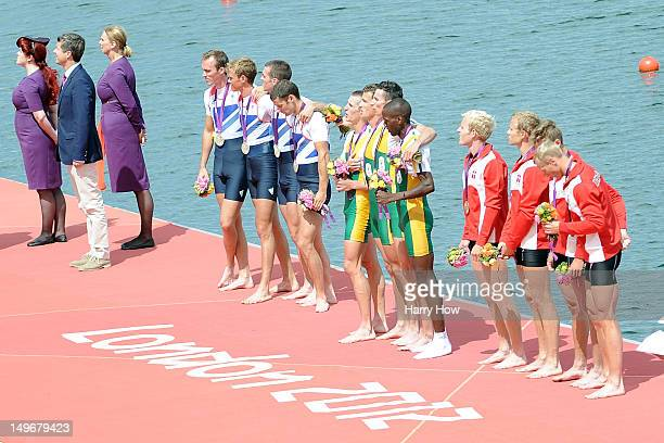 Prince Frederik of Denmark stand s next to Silver medalists great Britain gold medalists South Africa and bronze medalists Denmark as they pose with...