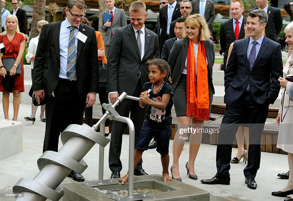 Prince Frederik of Denmark (2nd R) watches as a young child tries the Archimedes Screw water pump at the Darling Quarter water playground on November 21, 2011 in Sydney, Australia. Princess Mary and Prince Frederik are on their first official visit to Australia since 2008. The Royal visit begins in Sydney, before heading to Melbourne, Canberra and Broken Hill.