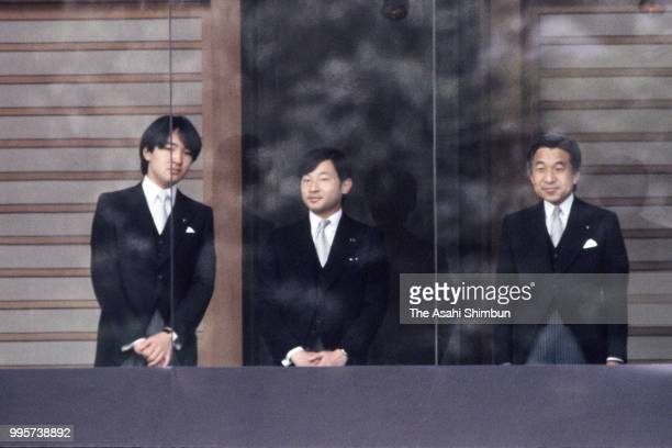 Prince Fumihito Prince Naruhito and Crown Prince Akihito attend the celebration session as Emperor Hirohito turns 85 at the Imperial Palace on April...