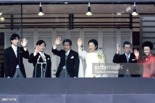 Prince Fumihito, Prince Naruhito, Crown Prince Akihito, Crown Princess Michiko, Prince Hitachi and Princess Hanako of Hitachi wave to well-wishers...