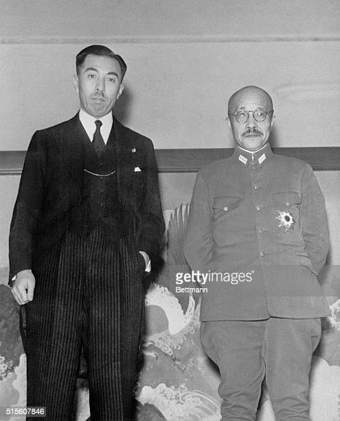 Prince Fumimaro Konoye outgoing premier and General Hideki Tojo the new one pose for the camera following a transfer of State affair