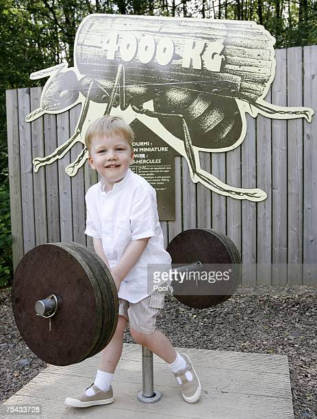 Prince Gabriel of Belgium plays during a walk in Park Chlrophylle on July 16 in Dochamps Belgium