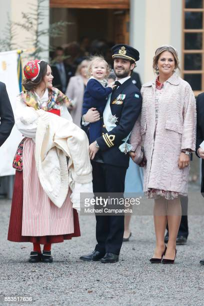 Prince Gabriel of Sweden Duke of Dalarna held by Princess Sofia of Sweden and Prince Carl Philip holding Prince Alexander Duke of Sodermanland and...
