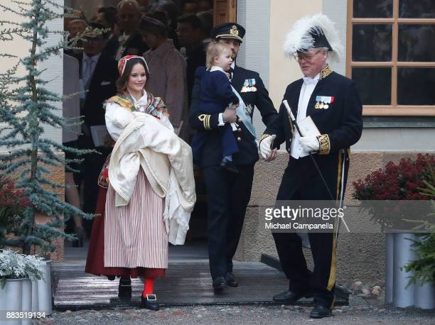 Prince Gabriel of Sweden Duke of Dalarna held by Princess Sofia of Sweden and Prince Carl Philip holding Prince Alexander Duke of Sodermanland leave...