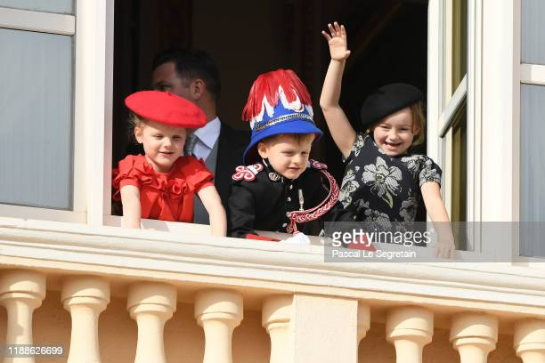 Prince Gabriella of Monaco, Prince Jacques of Monaco and Kaia-Rose Wittstock pose at the Palace balcony during the Monaco National Day Celebrations...