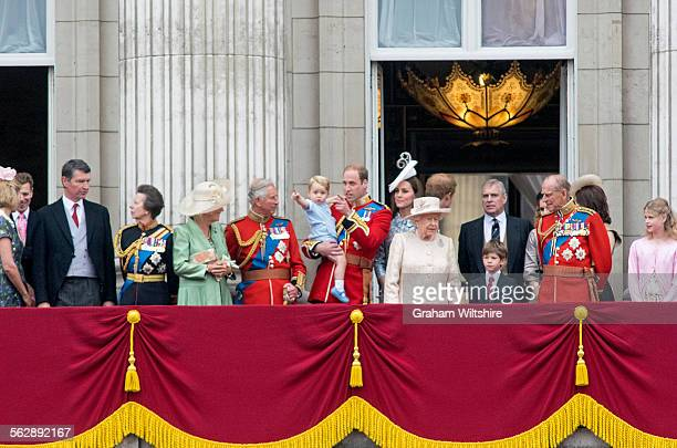 Prince George and Prince William with other members of the royal family spot the approaching Red Arrows display at the conclusion of the Trooping the...
