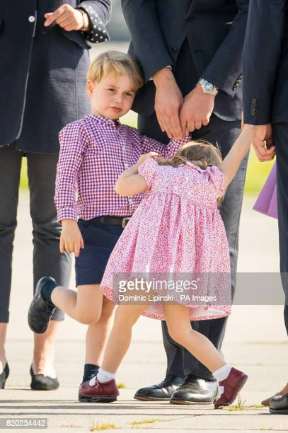 Prince George and Princess Charlotte wait with their parents the Duke and Duchess of Cambridge to board a plane in Hamburg at the end of their visit...