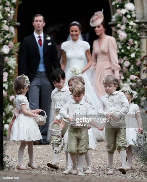 Prince George center stands with other flower boys and girls after the wedding of Pippa Middleton and James Matthews at St Mark's Church on May 20...