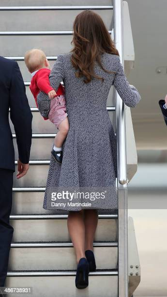 Prince George of Cambridge and Catherine Duchess of Cambridge depart Fairbairn Defence Base on April 25 2014 in Canberra Australia The Duke and...