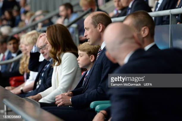 Prince George of Cambridge and Prince William, Duke of Cambridge and President of the Football Association look on from the stands prior to the UEFA...