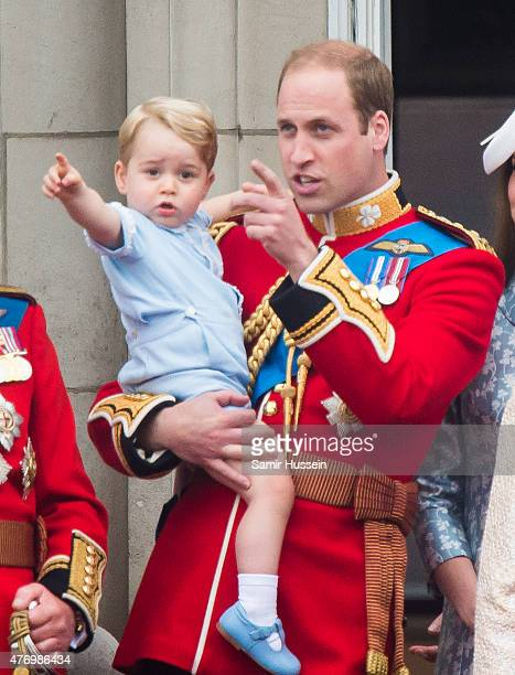 Prince George of Cambridge and Prince William Duke of Cambridge look on from the balcony during the annual Trooping The Colour ceremony at Horse...