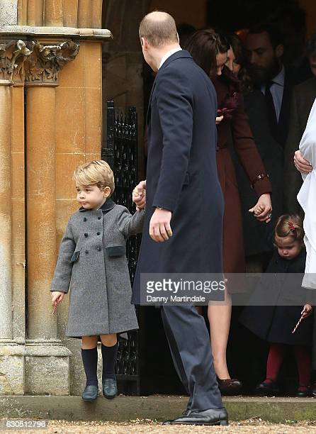 Prince George of Cambridge and Prince William Duke of Cambridge attend Church on Christmas Day on December 25 2016 in St Marks' Church in Englefield...