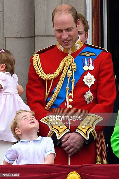 Prince George of Cambridge and Prince William Duke of Cambridge watch a fly past during the Trooping the Colour this year marking the Queen's 90th...