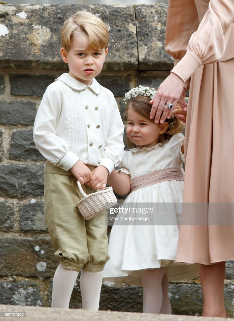 Prince George of Cambridge and Princess Charlotte of Cambridge attend the wedding of Pippa Middleton and James Matthews at St Mark's Church on May 20, 2017 in Englefield Green, England.