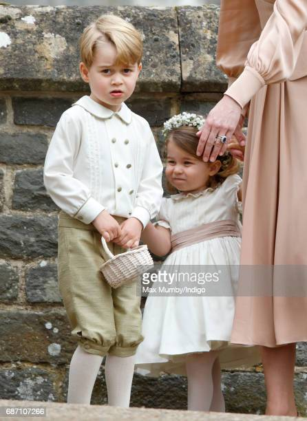 Prince George of Cambridge and Princess Charlotte of Cambridge attend the wedding of Pippa Middleton and James Matthews at St Mark's Church on May 20...