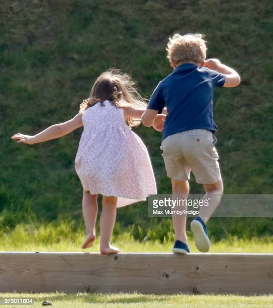 Prince George of Cambridge and Princess Charlotte of Cambridge attend the Maserati Royal Charity Polo Trophy at the Beaufort Polo Club on June 10...