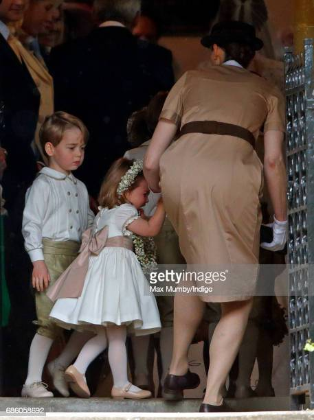 Prince George of Cambridge and Princess Charlotte of Cambridge accompanied by their nanny Maria Teresa Borrallo attend the wedding of Pippa Middleton...