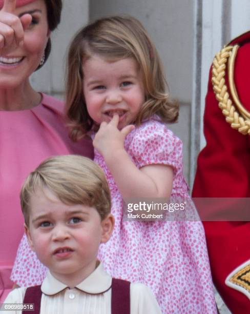 Prince George of Cambridge and Princess Charlotte of Cambridge on the balcony at Buckingham Palace during the annual Trooping The Colour parade on...