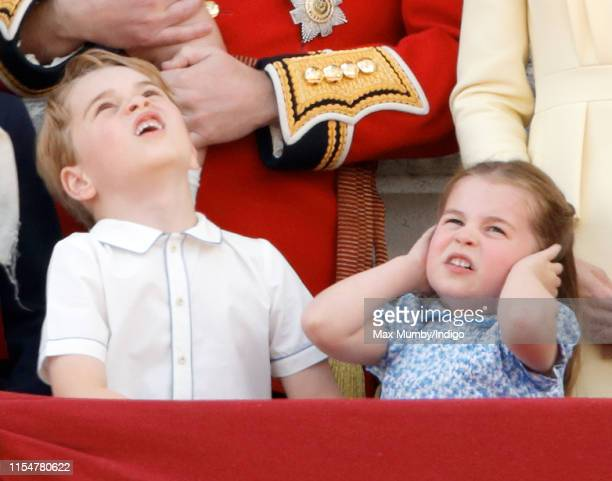 Prince George of Cambridge and Princess Charlotte of Cambridge watch a flypast from the balcony of Buckingham Palace during Trooping The Colour, the...